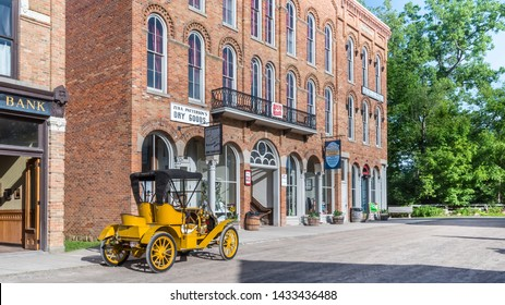 FLINT, MI/USA - JUNE 22, 2019: A 1908 Buick 10E car at Patterson's Dry Goods and Kirby's General Store the Sloan Museum Auto Fair car show, held at Crossroads Village, near Flint, Michigan.