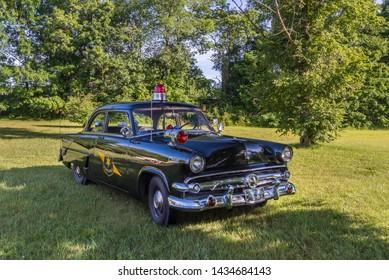 FLINT, MI/USA - JUNE 22, 2019: A 1954 Ford Mainline Police car at the Sloan Museum Auto Fair car show, held at Crossroads Village, near Flint, Michigan.
