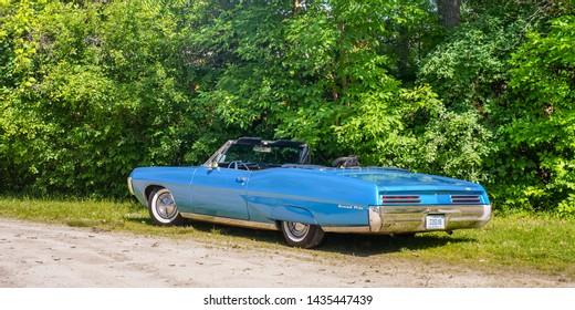 FLINT, MI/USA - JUNE 22, 2019: A 1967 Pontiac Grand Prix car at the Sloan Museum Auto Fair car show, held at Crossroads Village, near Flint, Michigan.