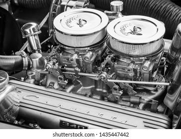 FLINT, MI/USA - JUNE 22, 2019: Close-up of a 1962 Chevrolet Corvette engine with Edelbrock intake at the Sloan Museum Auto Fair car show, held at Crossroads Village, near Flint, Michigan.