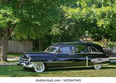 FLINT, MI/USA - JUNE 22, 2019: A Miller Cadillac hearse at the Sloan Museum Auto Fair car show, held at Crossroads Village, near Flint, Michigan.