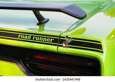 FLINT, MI/USA - JUNE 22, 2019: Close-up of a 1970 Plymouth Road Runner wing at the Sloan Museum Auto Fair car show, held at Crossroads Village, near Flint, Michigan.