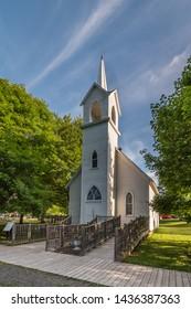 FLINT, MI/USA - JUNE 22, 2019: Historic Coldwater Road Chapel, at Crossroads Village, in Genessee County Park, in Flint, Michigan.