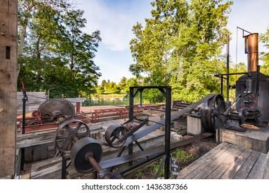 FLINT, MI/USA - JUNE 22, 2019: Historic Crossroads Lumber Company Sawmill and Mott Lake, at Crossroads Village, in Genessee County Park, in Flint, Michigan.