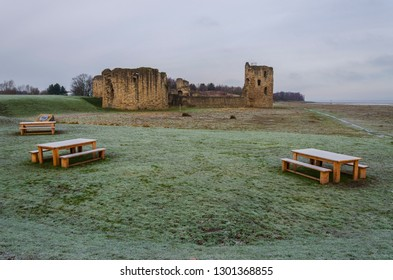 Flint, UK. January 31 2019. A sharp hoar frost coats the grass and picnic tables in front of Flint Castle.