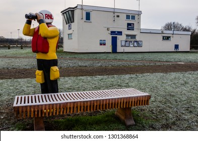 Flint, UK. January 31 2019. A sharp hoar frost coats the grass and wooden seating bench outside the RNLI lifeboat station at Flint. The lifeboat station is on the tidal estuary of the River Dee.