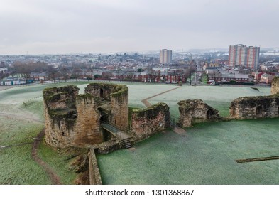 Flint, UK. January 31 2019. A sharp hoar frost coats the grassy area around Flint Castle. The town of Flint lies in the background.