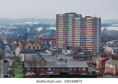 Flint, UK. January 31 2019. Frost covered rooftops in the foregorund with Flint town behind and the snow covered hillside in the background.