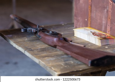 Flintlock on a wooden table