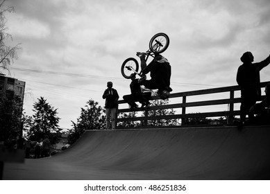 Flip by bike. Man making extreme trick by bicycle in the skatepark on competition. Sport concept for advertising. Copy space for a text or logo.