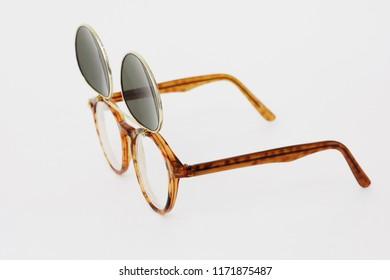 Flip up double lenses glasses on white background.