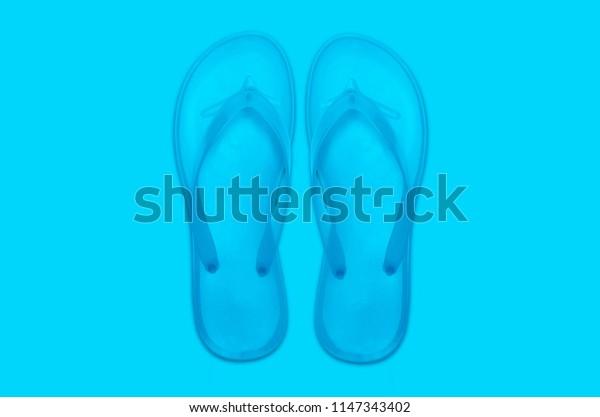 Flip flops abstract minimal blue background. Summer concept.