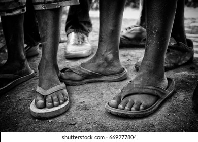 The flip flops of Americans on the feet of children n a third world country - thanks to donations and mission trips