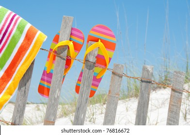 flip flops hanging on fence