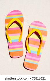 flip flops on beach sand
