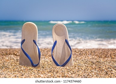 Flip flops on the beach with small stones