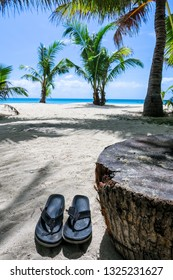 Flip Flops on Tropical Beach During Backpacking Trip to Asia