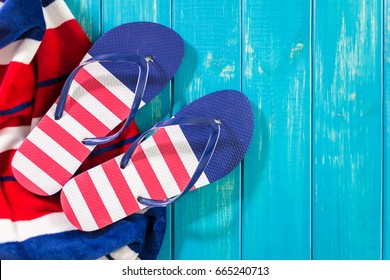 Flip flops with red white and blue pattern with July 4th theme.