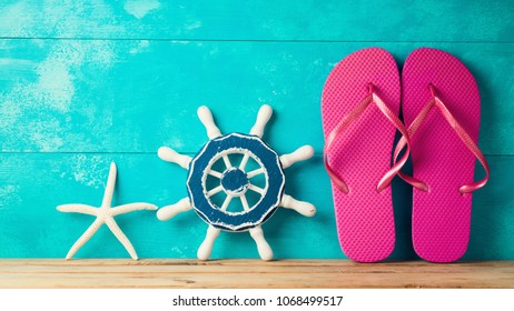 Flip flops and starfish decor over wooden background. Summer vacation concept