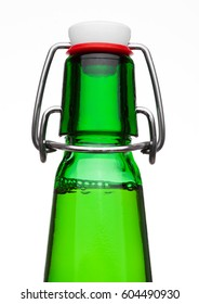 Flip top cap beer bottle green glass on white background