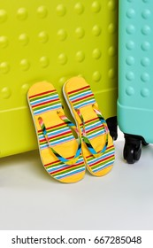 Flip tops, suitcases, white background. Meet summer adventure with bright accessories.