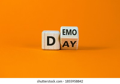 Fliped wooden cubes with concept words 'demo day' on a beautiful orange background. Copy space. Business and demo day concept.