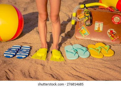 Flip-flops and children feet on the beach. Summer vacation concept