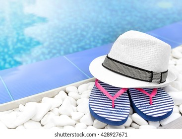 Flip Flops And Hat At The Pool On The White Gravel.