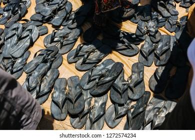flipflops made of old car tires in Uganda, Africa