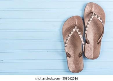 Flip-flops on color wooden background