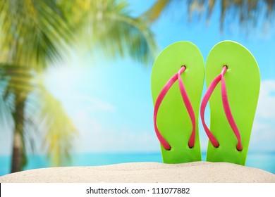 Flip-flops on sand beach.