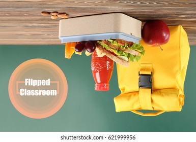 Flipped classroom concept. Inversed lunch on blackboard background
