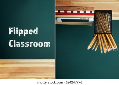 Flipped classroom concept. Inversed stationery with smartphone on blackboard background