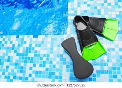 Flippers and aqua aerobics equipment at the swimming pool