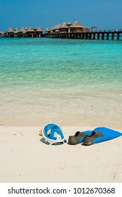 flippers and mask easy breath on the beach maldives and ocean