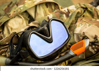 Flippers snorkel and mask for scuba diving lie on the sandy beach. Underwater hunting, a man in a neoprene wetsuit, underwater suit, disguised outfit, gun, harpoon diver camouflage