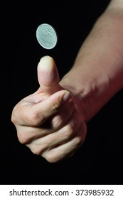 Flipping a coin with the right hand