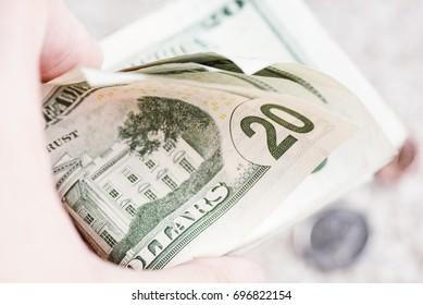 Flipping through 20 dollar bills. American US dollar currency.