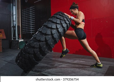Flipping tyre in gym