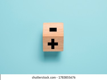 Flipping wooden cube block to change minus sign to plus sign on blue background. Positive thinking and mindset concept. - Shutterstock ID 1783855676
