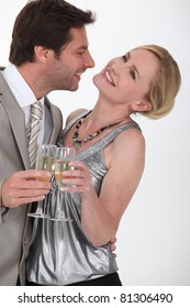 Flirtatious man and woman drinking champagne