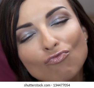 Flirtatious woman with closed eyes.