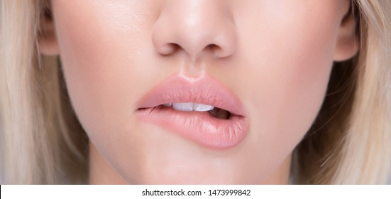 Flirting sexy girl bite her juicy lips. Close up shot.