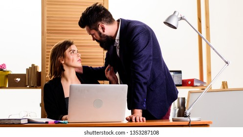 Flirting at workplace entirely unprofessional. Flirting and seduction. Flirting with coworker. Woman flirting with guy coworker. Woman attractive lady with man colleague. Office collective concept.