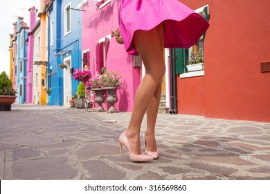 Flirty lady in pink skirt