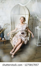 Flirty portrait of a beautiful woman in vintage dress with her knees not covered