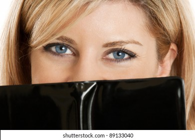 Flirty woman's eyes with little black book