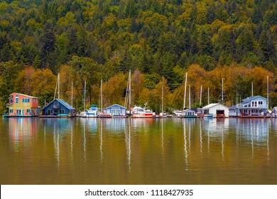 Flloating homes houseboats along Multnomah Channel in Portland Oregon in Fall Season