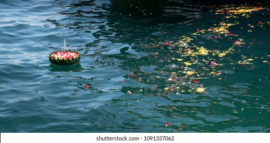 float decorate with Banana leaf and rose petals for water burial funeral ceremony.