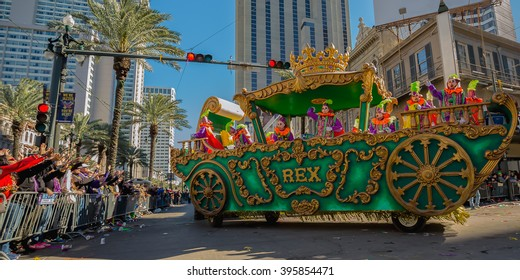A float from the Krewe of Rex turns on to Canal St from Sta Charles Ave in New Orleans Louisiana during Mardi Gras Day 2016